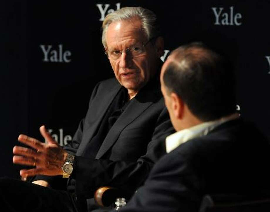 Washington Post journalist Bob Woodward left speaks with journalist and teacher Steven Brill at the Yale University Art Gallery in New Haven. Photo by Mara Lavitt/New Haven Register11/18/10