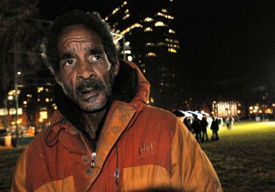 Joe Comfort, a homeless man in New Haven, stands on the New Haven Green, where the city's Community Services Administration held its third annual Tent City on the Green fundraiser Thursday evening. (Melanie Stengel/Register)