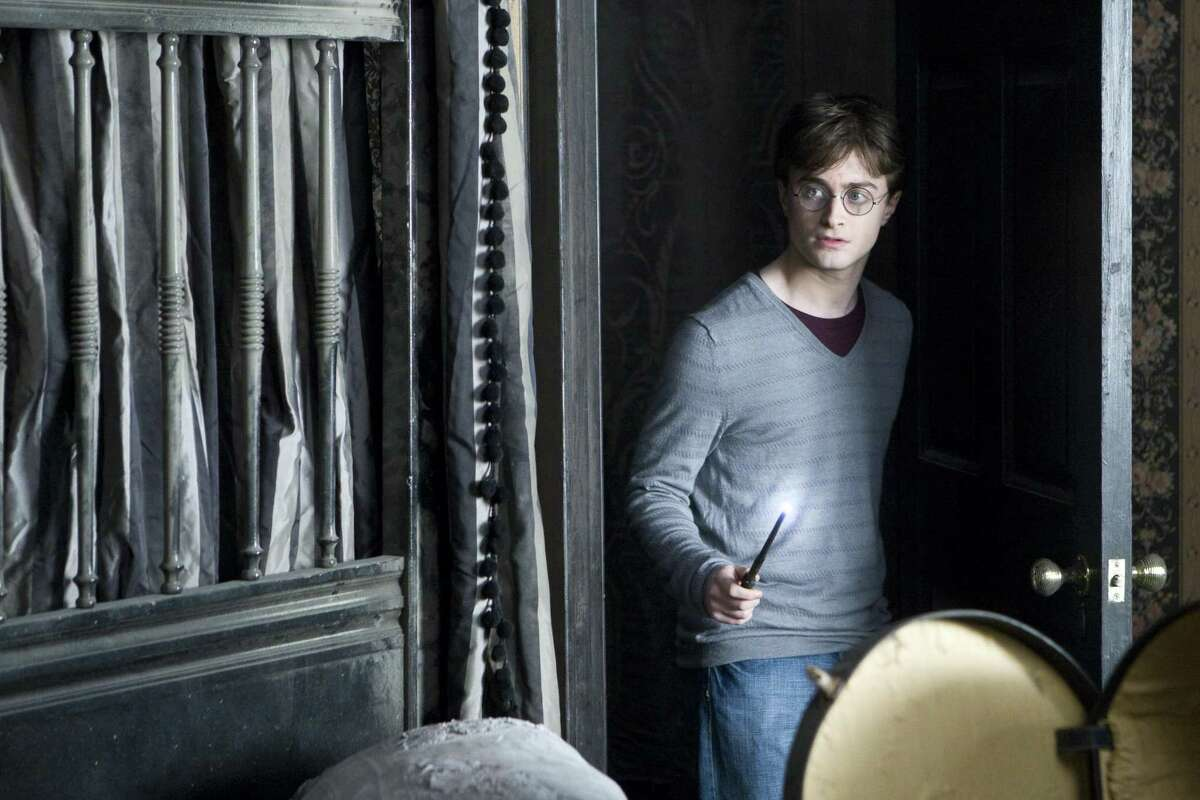 In this film publicity image released by Warner Bros., Daniel Radcliffe portrays Harry Potter in a scene from