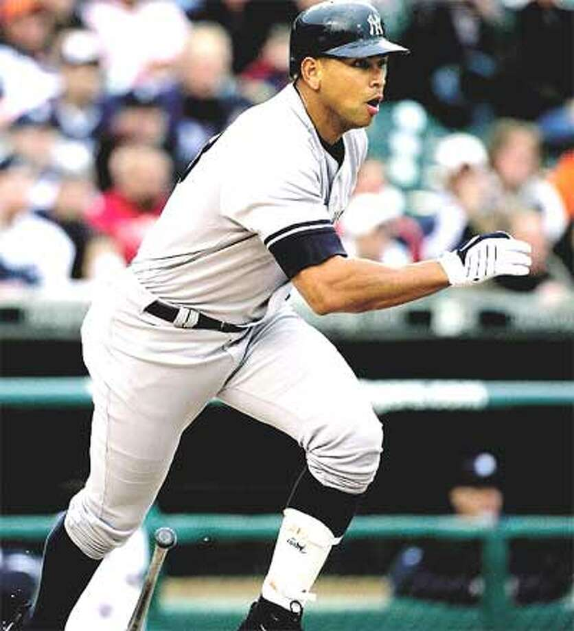 The Yankees' Alex Rodriguez delivers an RBI single in the first inning of Wednesday's second game of a day-night doubleheader against the Detroit Tigers. That first-inning run was all the Yankees needed as they took the nightcap 8-0. They could have used some of those runs in the opener as they lost 2-0. (Associated Press)