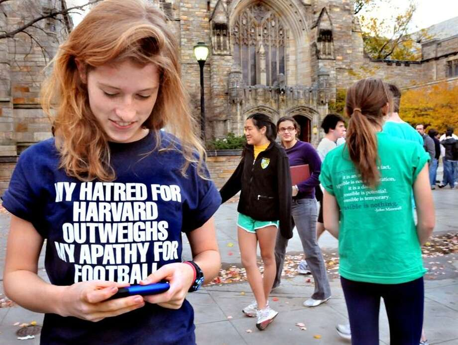 A Yale freshman, who identified herself only as Katie, watches the Harvard-made video spoofing life at Yale. She said she found the video neither offensive nor funny. Melanie Stengel/Register