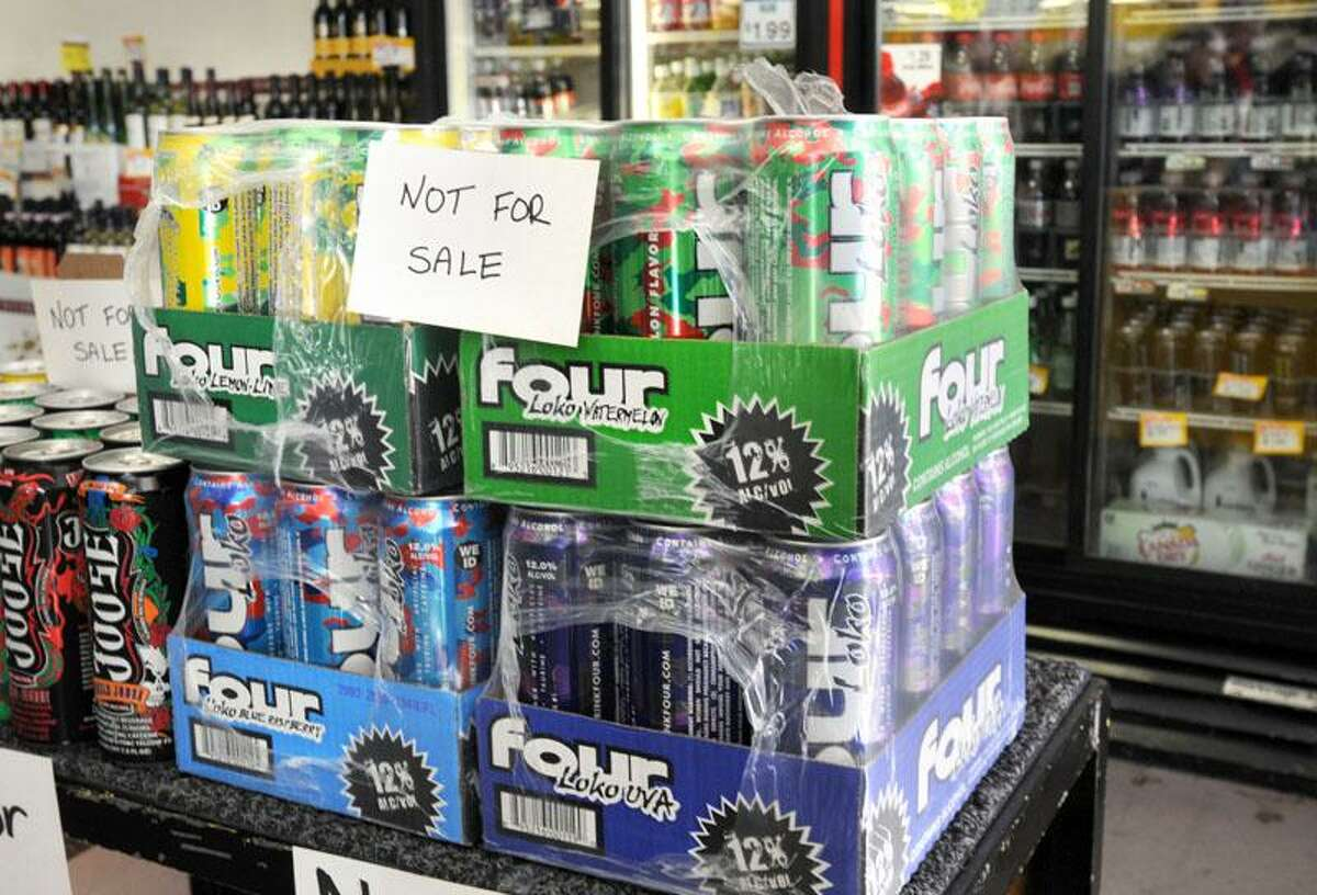 Attorney General Richard Blumenthal right called for a halt to alcoholic energy drink sales at a press conference at Sav-Rite Liquors in North Haven which has pulled the drinks from the store's shelves. Photo by Mara Lavitt/New Haven Register11/17/10