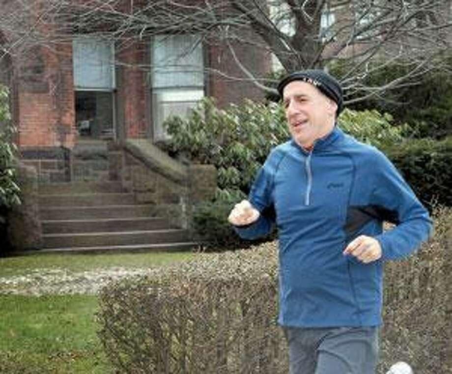 Attorney, Ken Rosenthal, runs past his New Haven office. He will be participating in the Boston Marathon. (Melanie Stengel/Register)