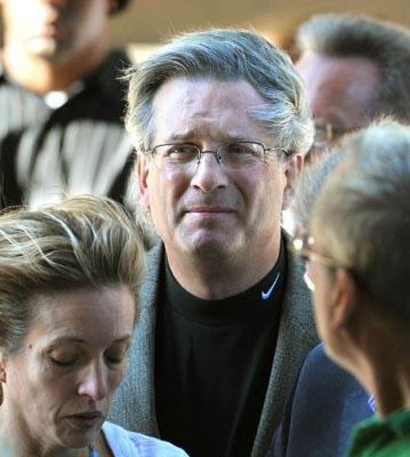 Dr. William Petit with his sister Johanna Chapman arrive at Superior Court on Wednesday. (Peter Casolino/Register)