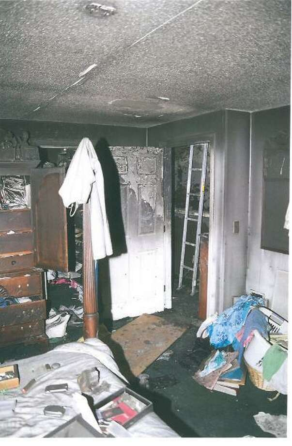 This photo shows some of the fire damage inside the Petit's bedroom.