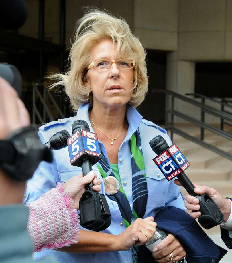 Cynthia Hawke-Renn speaks to the media outside Superior Court in New Haven Thursday after court adjourned. Photo by Brad Horrigan