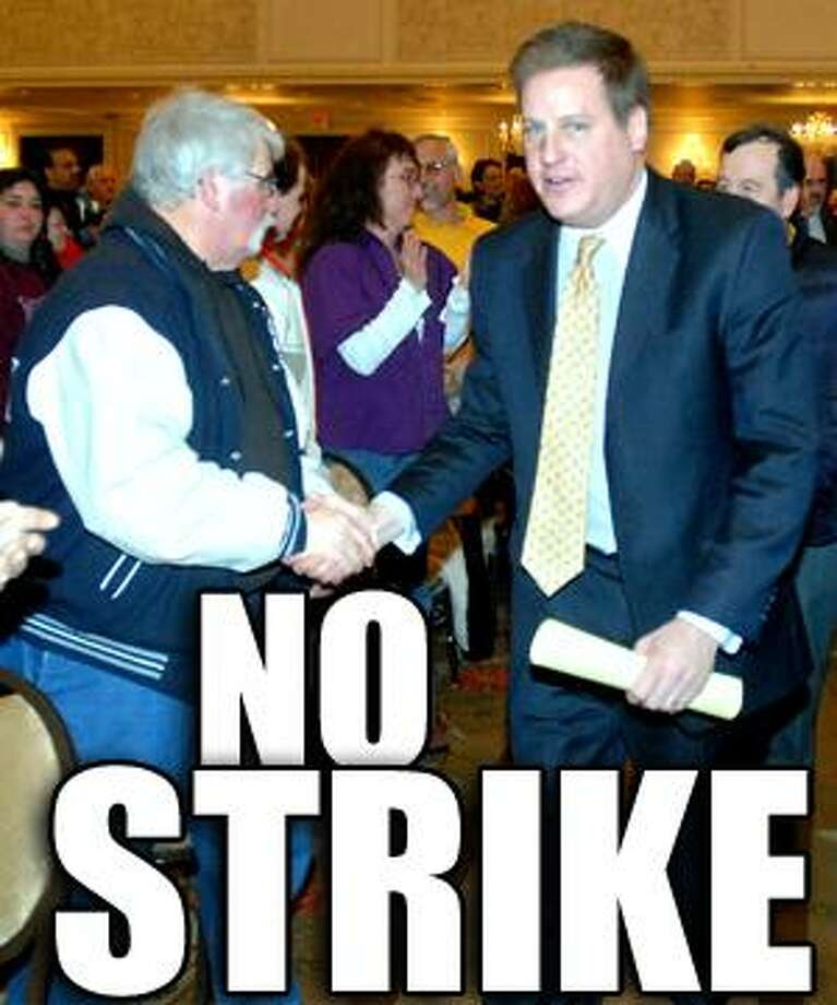 Brian Petronella (center), president of Local 371 of the United Food and Commercial Workers Union, shakes hands with Stop & Shop employees at the Omni New Haven Hotel at Yale in New Haven before a contract vote on 3/7/2010.Photo by Arnold Gold   AG0355A