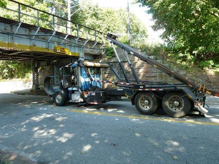 A Dainty Rubbish Services truck driver died when the boom of his truck rammed into the 11-foot, 10-inch Hull Street Amtrak bridge in Clinton Tuesday.