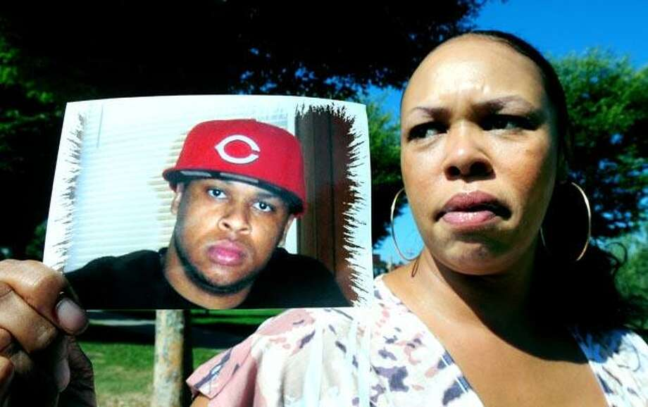 Alison Baldwin is photographed on 9/14/2010 with a picture of her son, Rodney Trent Baldwin, who was shot and killed last year in Derby. Photo by Arnold Gold