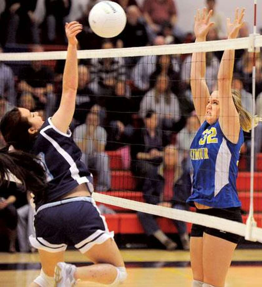 Morgan's Danielle Susara and Seymour's Stephanie Burt at the net in the 4th game of the Class S semi final match. (Melanie Stengel/Register)