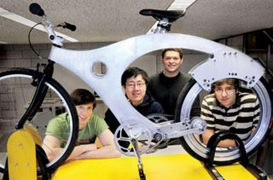 Yale Unversity seniors, from left, Sean McCusker, Derek Zhao, Gregory Brown and Jordan Carter, designed and built a spokeless bike wheel for a class project. (Melanie Stengel/Register)