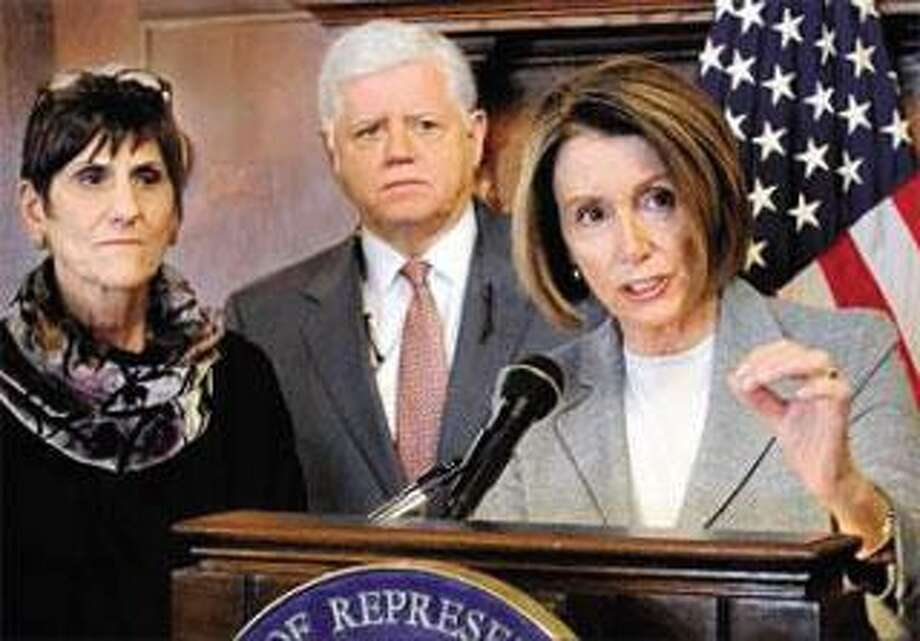 From left, U.S. Reps. Rosa DeLauro, and John Larson join House Speaker Nancy Pelosi as she speaks about health care at the Graduate Club in New Haven Saturday. (Melanie Stengel/Register)