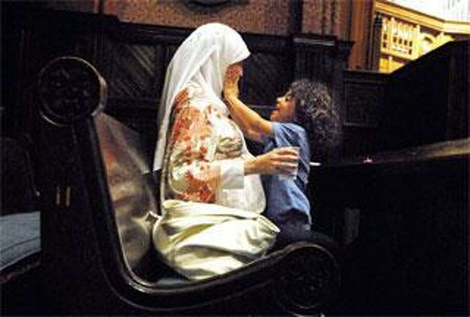 Marwa El-Sayed and her son, Adam Masoud, 4, share a moment during an iftar in Battell Chapel at Yale. An iftar is when Muslims break their daily fast after dusk during the holy month of Ramadan. El-Sayed and her son live in Cairo, Egypt, but were visiting a friend who is a professor at Yale. (Brad Horrigan/Register)