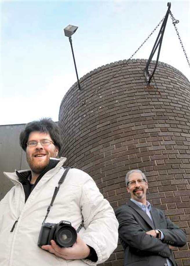 Terrance Vasseur, left, of West Haven and his photography teacher Harold Shapiro of Guilford near Bridges, a social service agency in West Haven where Terrance is a student of Harold's. (Mara Lavitt/New Haven Register)