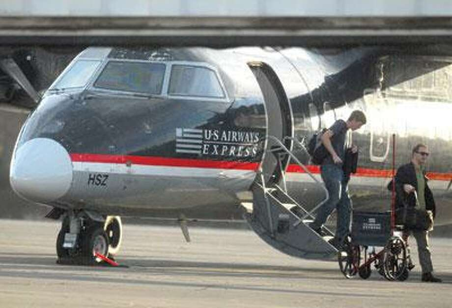 Passengers disembark from a US Airways flight at Tweed New Haven Regional Airport Sunday. (Brad Horrigan/Register)