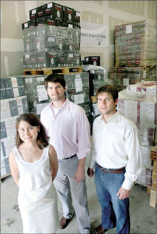 Arnold Gold/Register Votto Vines Importing saleswoman Leah Votto, left, and two of the owners, Jeremy Jerome, center, and Nicholas Votto pause at the warehouse in Hamden.