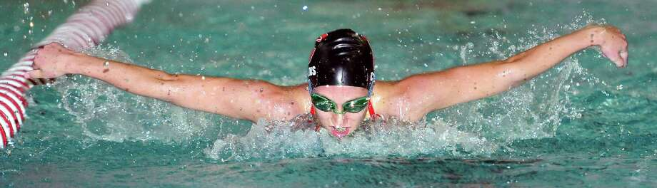 Katie Collins of Cheshire swims to a second place finish in the 100 meter butterfly at Branford on 10/26/2010.Photo by Arnold Gold   AG0390B
