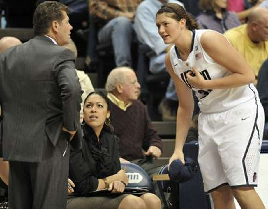 This photo taken Nov. 14, 2010 shows Connecticut head coach Geno Auriemma, left, talking with  6-foot-5 freshman Stefanie Dolson, right, during the second half of an NCAA college basketball game against Holy Cross, in Storrs, Conn.  Connecticut will face No. 2 ranked Baylor with Baylor's star, 6-foot-8 Brittney Griner.  (AP Photo/Jessica Hill) Photo: AP / AP2010