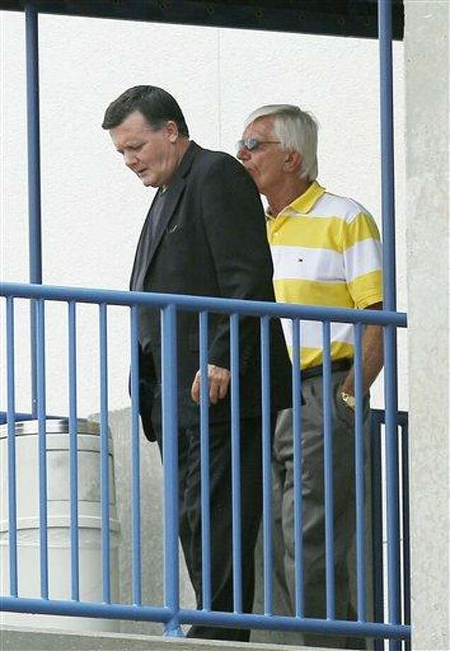 New York Yankees co-chairman Hank Steinbrenner, left, son of New York Yankees owner George Steinbrenner and John Szponar, a New York Yankees vice president, stand on the balcony outside George M. Steinbrenner Field, the spring training home of the New York Yankees Tuesday, July 13, 2010, in Tampa, Fla. George Steinbrenner died Tuesday morning, July 13, 2010 in Tampa, Fla. He was 80. (AP Photo/Chris O'Meara) Photo: AP / AP