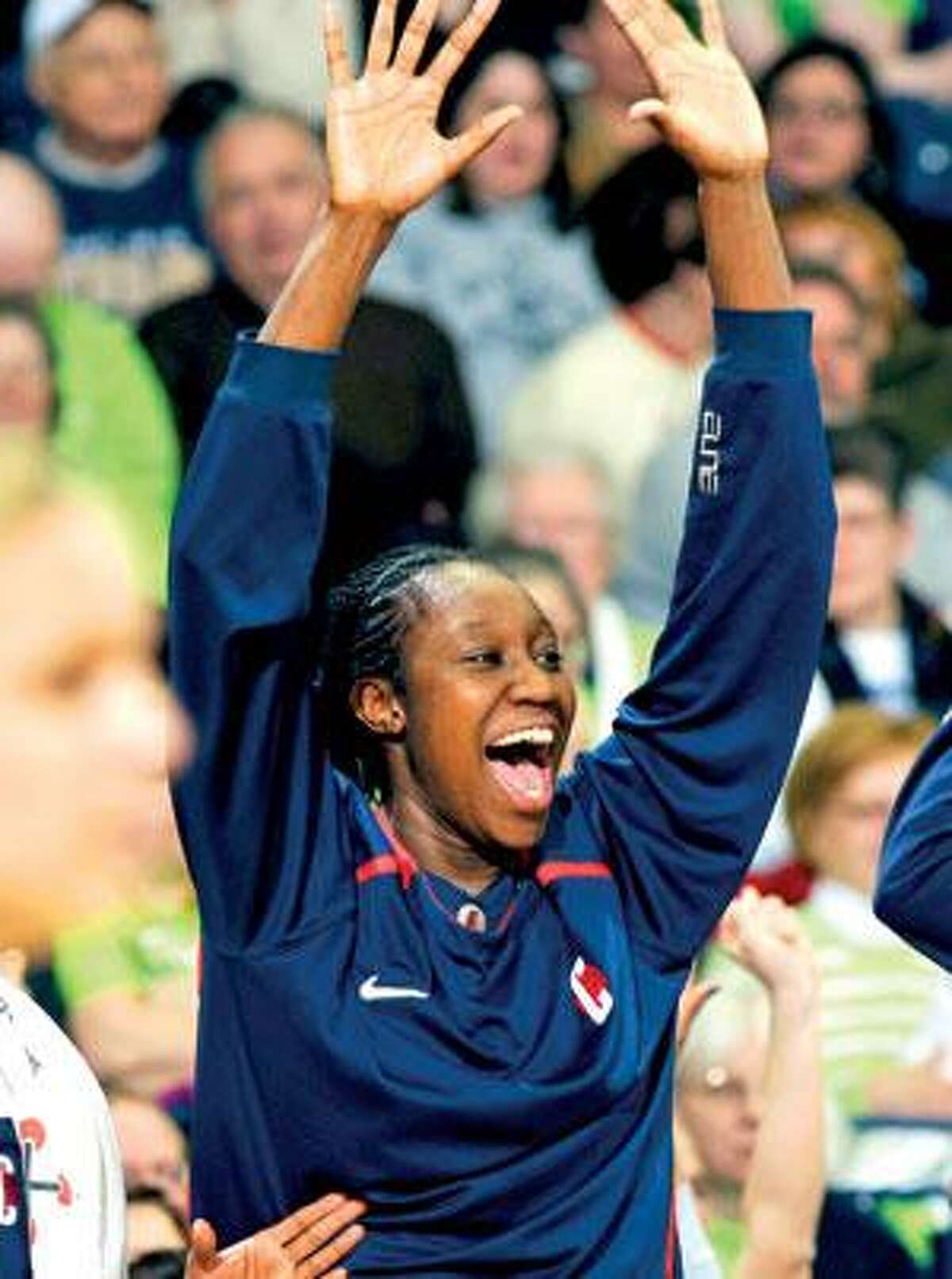 Tina Charles picked up two UConn records on Monday, becoming the school's career leading scorer and rebounder as the Huskies won their 69th straigh game with a victory over Notre Dame in South Bend, Ind. (Associated Press)