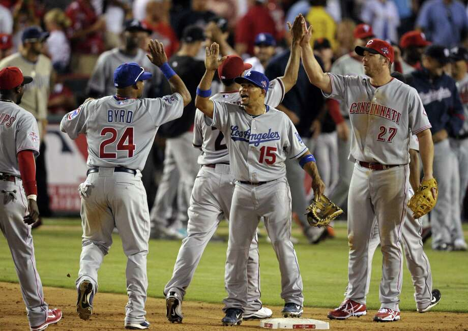 The National League all-stars celebrate after the senior circuit won its first all-star game since 1996, 3-1 over the American League Tuesday night in Anaheim, Calif. (Associated Press/Jae C. Hong) Photo: ASSOCIATED PRESS / AP