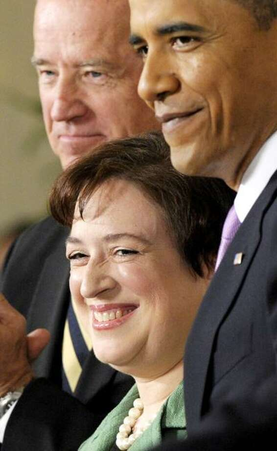 Solicitor General Elena Kagan stands with President Barack Obama and Vice President Joe Biden as she is introduced as Obama's nominee for the Supreme Court during an announcement in the East Room of the White House in Washington, Monday, May 10, 2010. (AP Photo/Susan Walsh) Photo: AP / AP