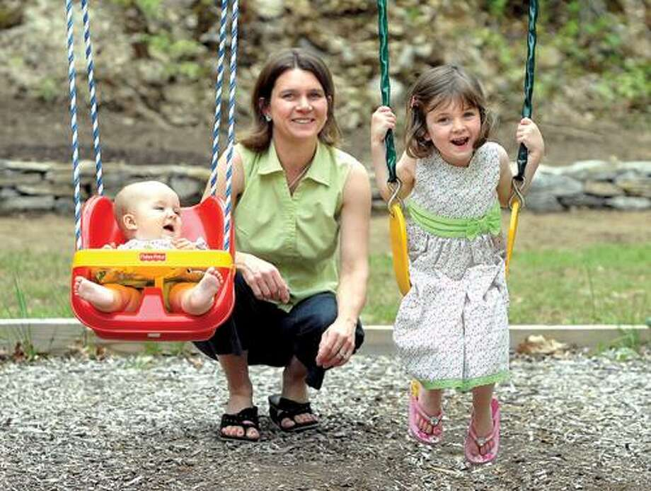 Erin Hansted at home in Killingworth with daughters, Vayda, 10 months; and Emmalena, 4. Mara Lavitt/Register
