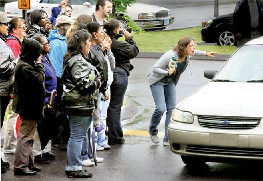 Strikers confront a car crossing the picket line at Birmingham Health Center in Derby Saturday. Melanie Stengel/Register