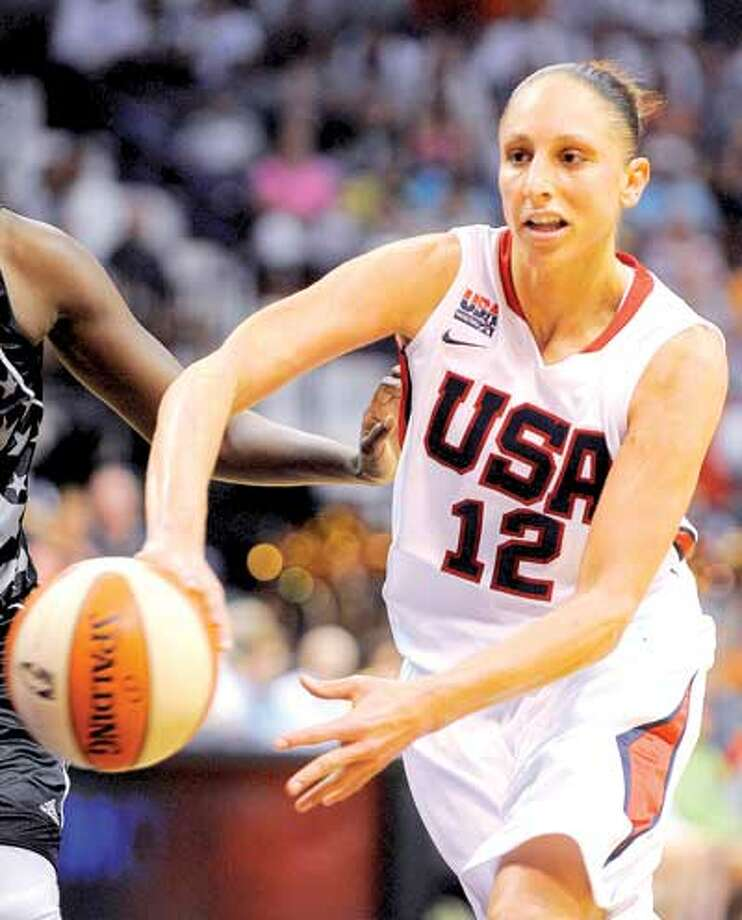 Diana Taurasi was back in Connecticut helping Team USA beat the WNBA All-Stars 99-72 at the Mohegan Sun Arena in Uncasville on Saturday. (Associated Press)