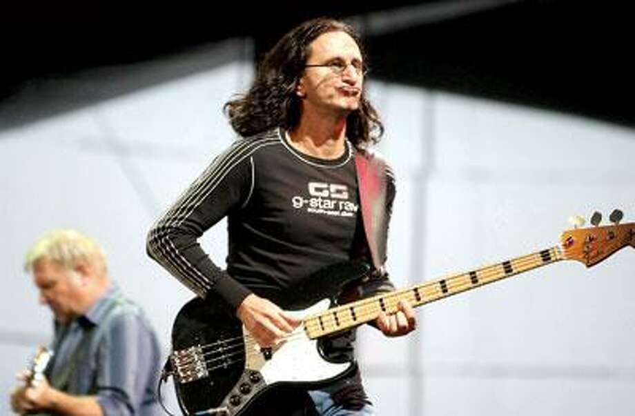 """Bassist/singer Geddy Lee will lead the iconic Canadian rock band Rush when it takes the stage at Mohegan Sun on July 19. The trio will be playing its classic record """"Moving Pictures"""" in its entirety. (Associated Press)"""