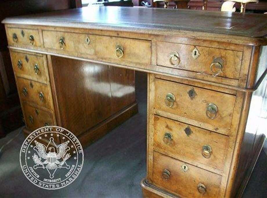 This undated picture made available by Proxibid, Gaston and Sheehan and the U.S. Marshals Service shows an antique wooden desk, part of thousands of belongings from Bernard Madoff's New York City penthouse on the auction block in New York on Saturday, Nov. 13, 2010. When Madoff was arrested two years ago, U.S. marshals seized everything from his and his wife's daily life. The proceeds will go to more than 3,000 clients Madoff swindled in a multi-billion dollar Ponzi scheme. The 72-year-old former Wall Street trader is serving a 150-year sentence in a North Carolina prison. (AP Photo/Proxibid, Gaston and Sheehan, U.S. Marshals Service) Photo: AP / Proxibid, Gaston and Sheehan, U.S. Marshals Service