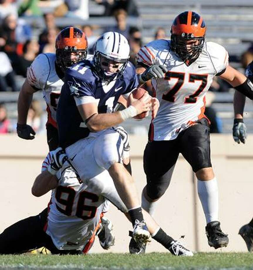 New Haven-- Yale QB Patrick Witt breaks through the line against Princeton during the third quarter. Photo by Peter Casolino/New Haven Register 11/10/10 Cas101110