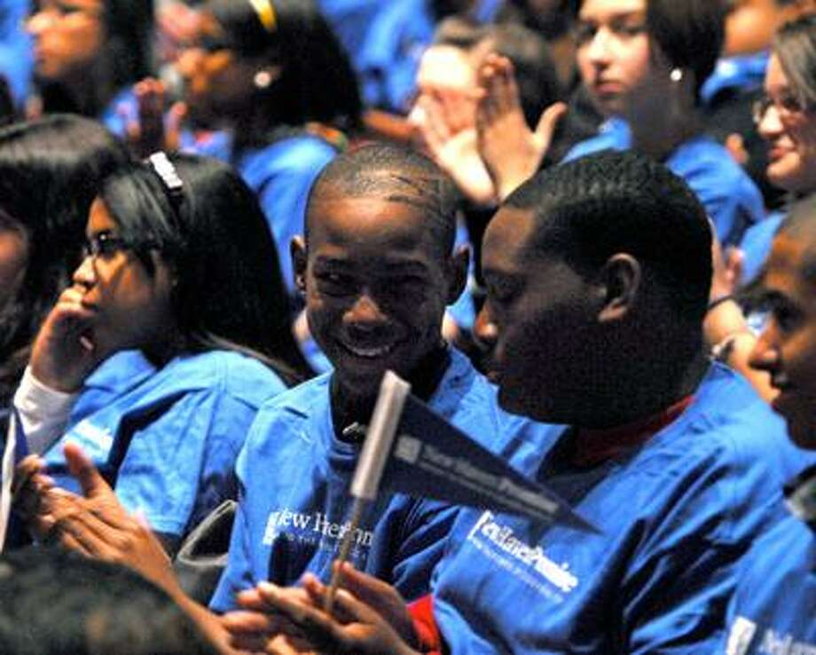 New Haven--Students applaud Tuesday's announcement of the New Haven Promise program at Cooperative Arts & Humanities High School.  Photo by Brad Horrigan/New Haven Register-11.09.10.BH0709-101109