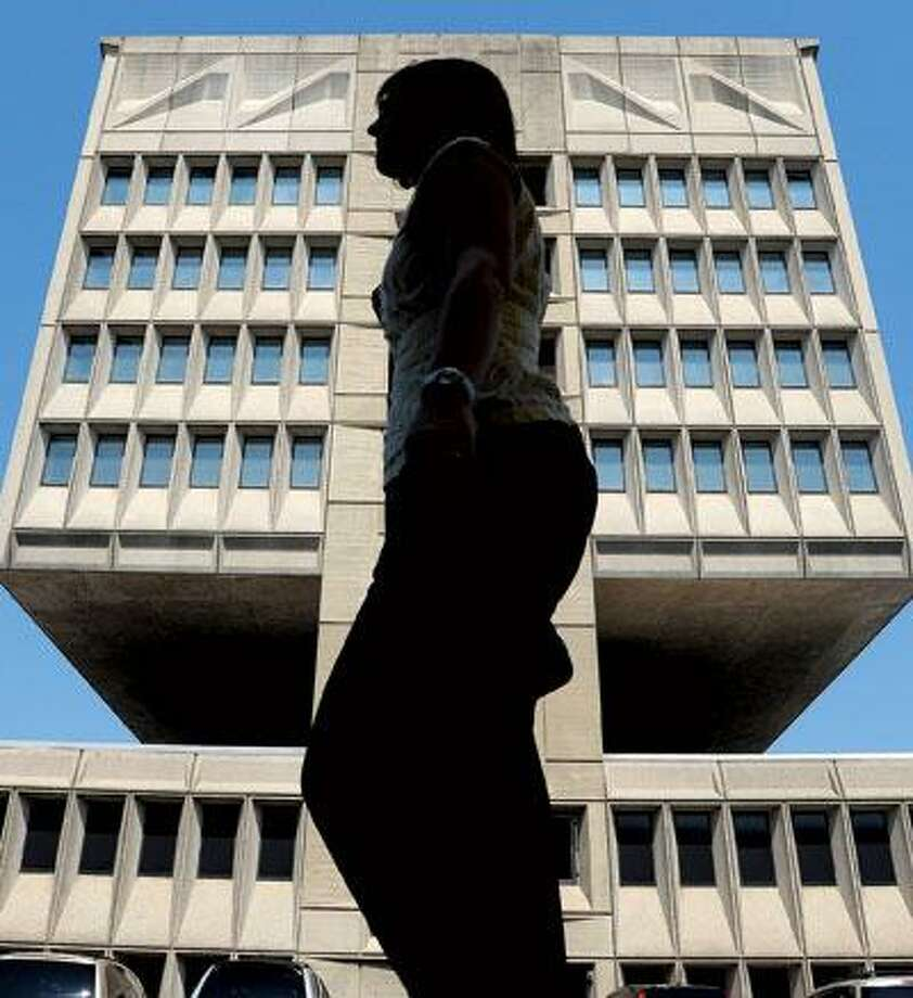 A person walks by the vacant Pirelli Building next to Ikea in New Haven. (Brad Horrigan/Register)