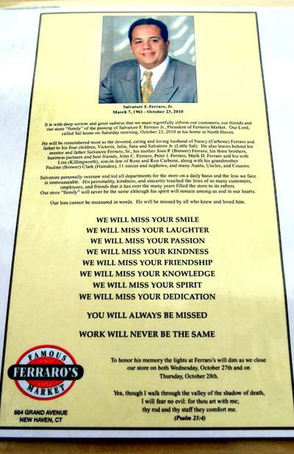 A notice about the death of Salvatore F. Ferraro, Jr., president of Ferraro's Market, hangs in front of the New Haven store on 10/26/2010.Photo by Arnold Gold   AG0390B