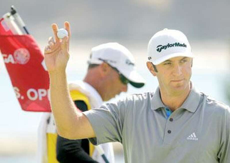 Dustin Johnson reacts after making an eagle on the fourth hole Saturday. (Associated Press)
