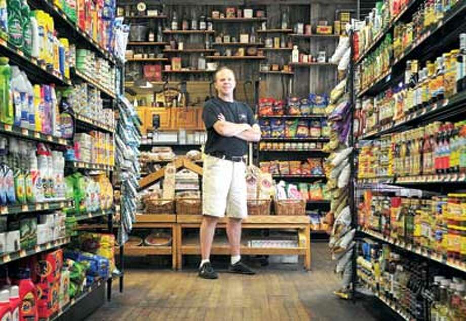 Ron Rosa, the owner of Guilford Food Center, is concerned about Costco's possible move into town. Brad Horrigan/Register