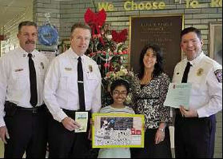 Contributed photo  From left: Acting Fire Marshal Keith Flood of the Center District;, Allingtown Deputy Fire Chief Chris Reed, Alma E. Pagels School fourth-grader Poorna Balakumar, Pagels Principal Gina Prisco and West Shore Deputy Fire Chief Patrick Pickering.