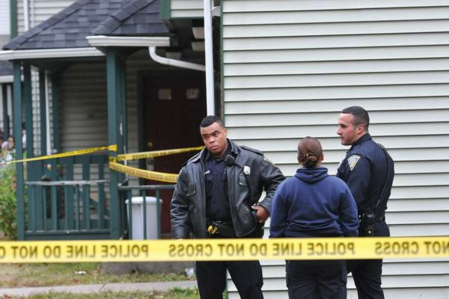 New Haven-- Police wait for the medical examiner to arrive outside the scene of shooting at 14 Garden Street. Photo/Peter Casolino
