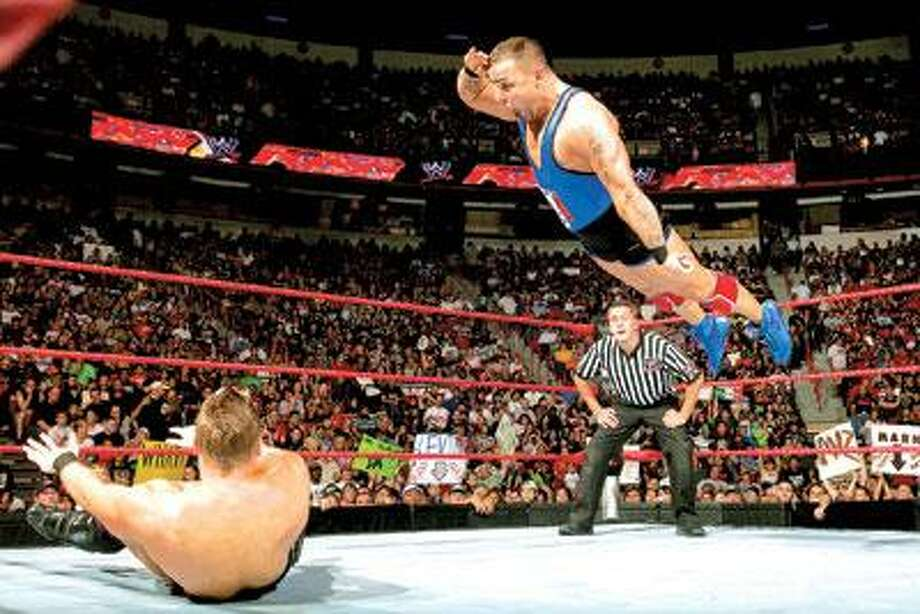 """Rey Mysterio leaps over Dolph Zigler on WWE's """"Friday Night SmackDown. (2009 World Wrestling Entertainment, Inc. All Rights Reserved)"""