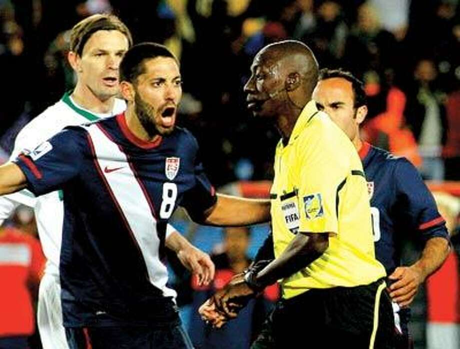 Clint Dempsey, left, yells at Koman Coulibaly after the referee disallowed a United States goal in the closing minutes of an eventual 2-2 tie between the U.S. and Slovenia in a World Cup group C match Friday at Ellis Park Stadium in Johannesburg, South Africa. (Associated Press)
