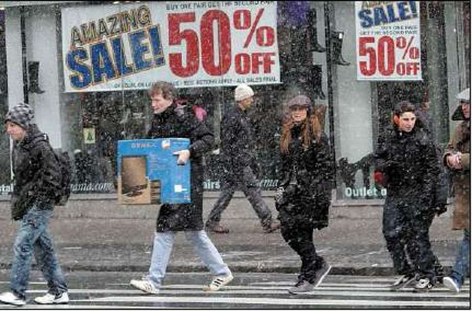 Associated Press  Even a little snow couldn't stop these shoppers at New York's Union Square