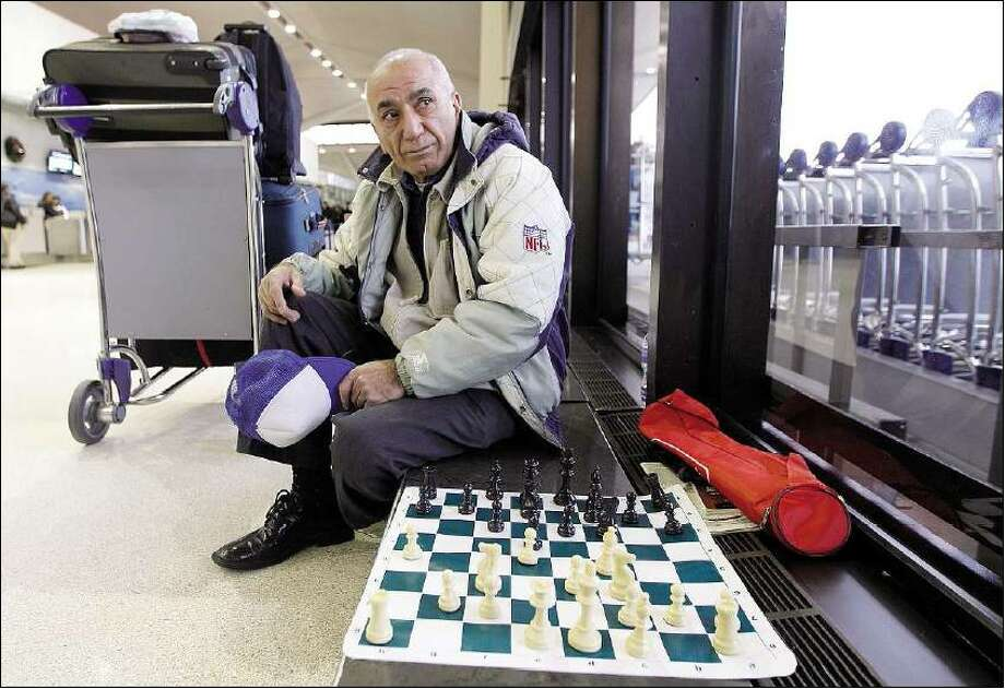Associated Press  Morris Farimi, 70, of Philadelphia waits for a challenger in a game of chess after finding out his flight to Germany had been canceled at Newark Liberty International Airport.