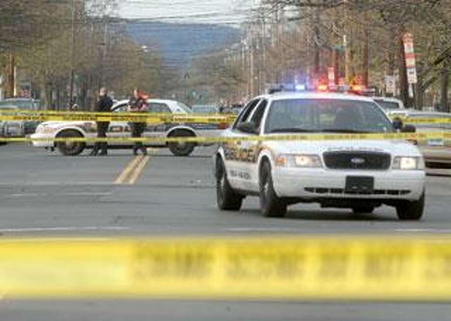 Dixwell Avenue was blocked after Sunday's shooting. (Brad Horrigan/Register).