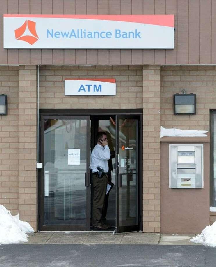 An investigator stands in doorway of bank after robbery. Mara Lavitt/Register.