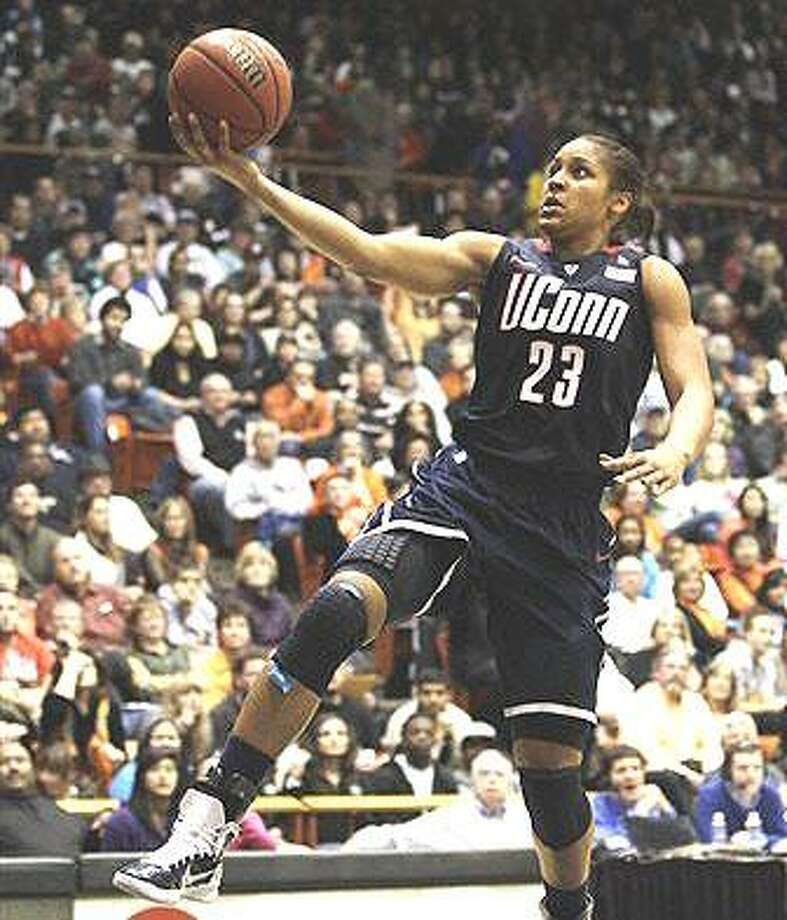 Connecticut forward Maya Moore scores on a breakaway layup against Pacific during the first half of an NCAA college basketball game in Stockton, Calif., Tuesday, Dec. 28, 2010. (AP Photo/Marcio Jose Sanchez)