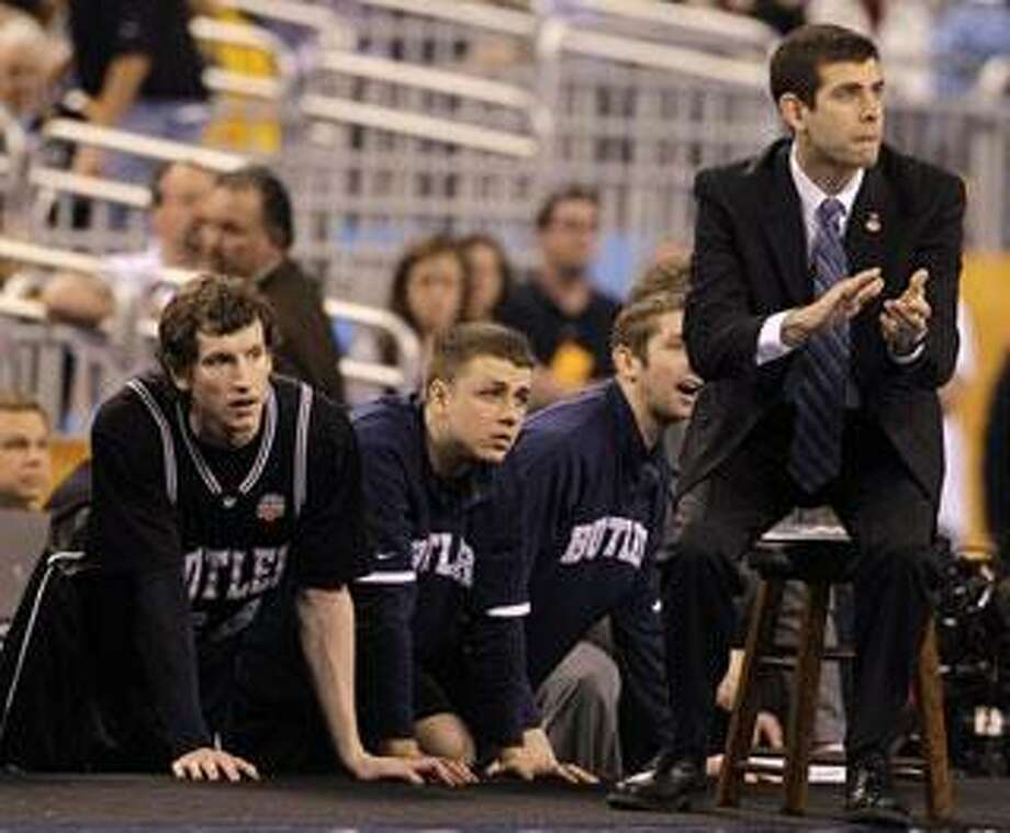 Butler head coach Brad Stevens, right, looks on with his team during the first half of a men's NCAA Final Four semifinal college basketball game against Michigan State Saturday, April 3, 2010, in Indianapolis. (AP Photo/Darron Cummings)