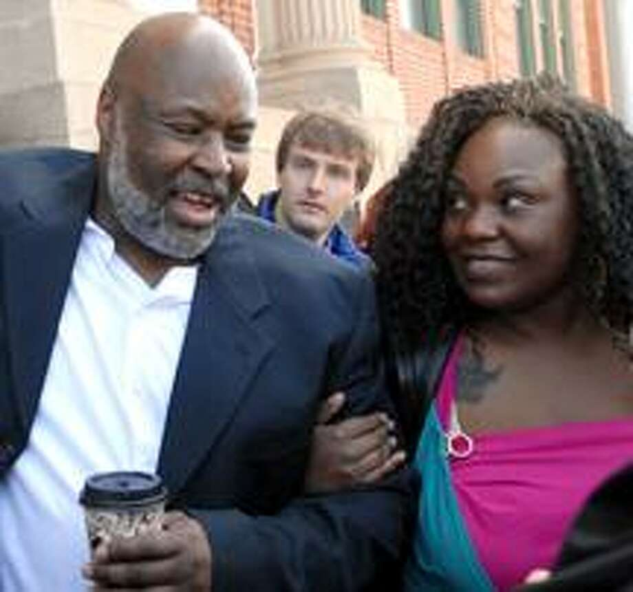 George Gould, left  with his daughter April Henderson celebrating his release in front of Rockville Superior Court Thursday after spending 16-years in prison for a  1993 murder in Fair Haven he did not commit.  (PETER HVIZDAK/Register)