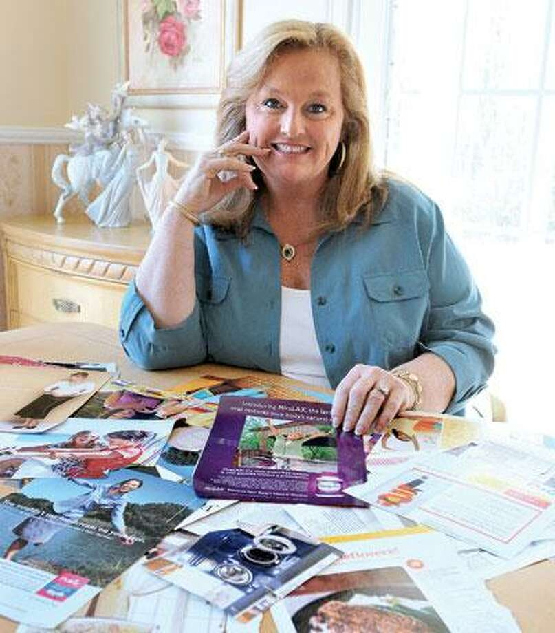 Lisa Lelas of Guilford describes a treasure map as simply a poster board upon which you put pictures of things that you want to happen in your life, or of images that evoke the feelings you wish to have. (Peter Casolino/Register)