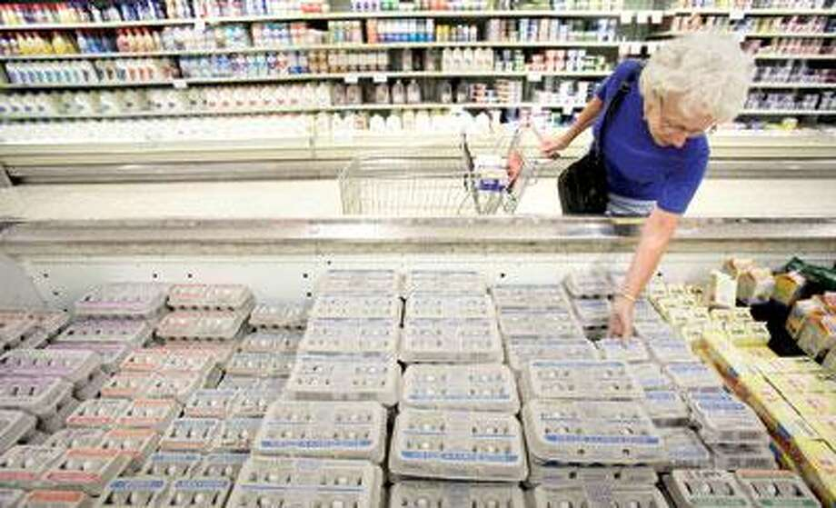 Janet Weaver, of Des Moines, Iowa, shops for eggs at a Dahl's grocery store in Des Moines, Iowa. A sign on the cooler said the eggs were not affected by the recall. (AP Photo)